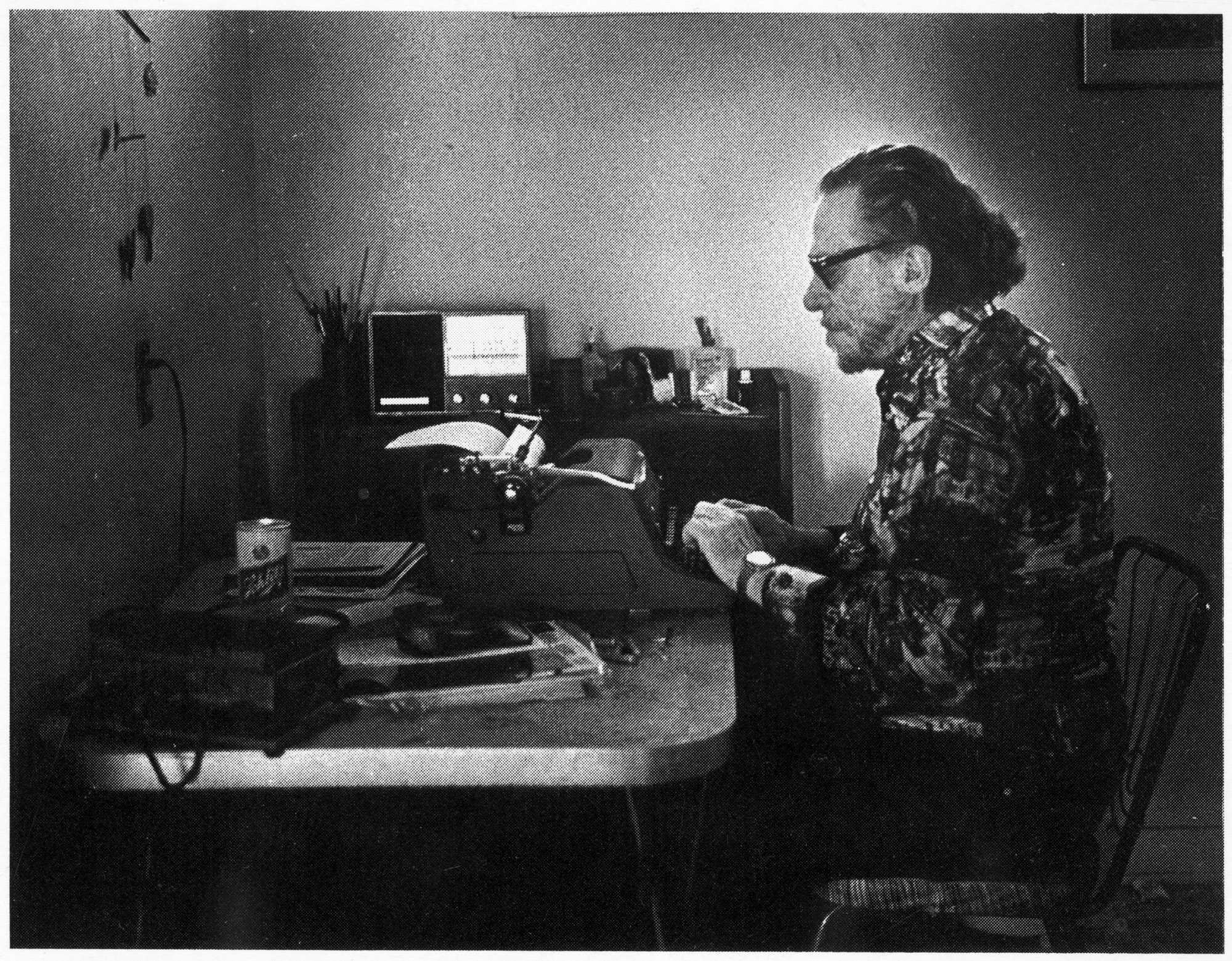 Postcard featuring Charles Bukowski at his typewriter in 1988. Photo by Joan Levine Gannij, published by Island International Bookstore, Amsterdam. Courtesy of the Huntington Library, Art Collections and Botanical Gardens. (HAND IN PHOTO 9-29-10)